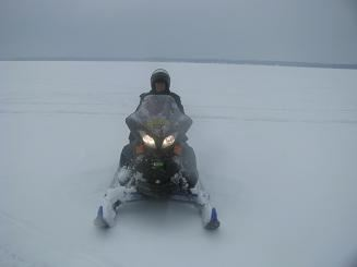 Deputy Riding Snowmobile